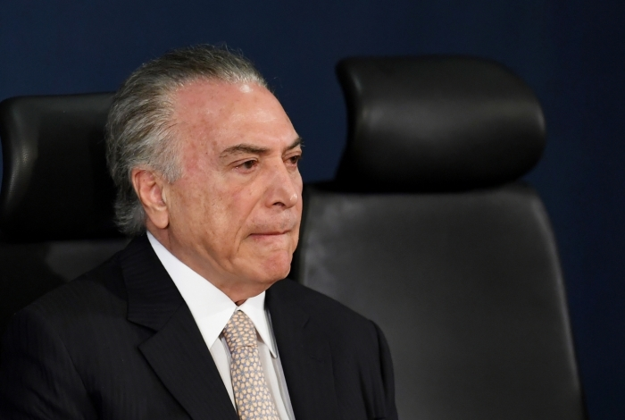 Brazilian President Michel Temer attends the inauguration of the country's new Attorney General, Raquel Dodge, in Brasilia on September 18, 2017. Dodge took over to oversee an avalanche of corruption investigations, including against President Michel Temer, and promised that no one would be