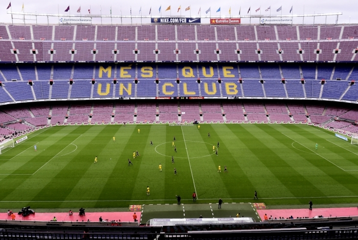 Spectator tribunes remain empty as the Spanish league football match FC Barcelona vs UD Las Palmas is played behind closed doors at the Camp Nou stadium in Barcelona on October 1, 2017. Barcelona's La Liga match against Las Palmas was played behind closed doors after the Spanish league refused to postpone the match. At least 91 people have been injured in clashes between police and activists in Catalonia over an independence referendum for the region deemed illegal by the Spanish government. / AFP PHOTO / JOSE JORDAN