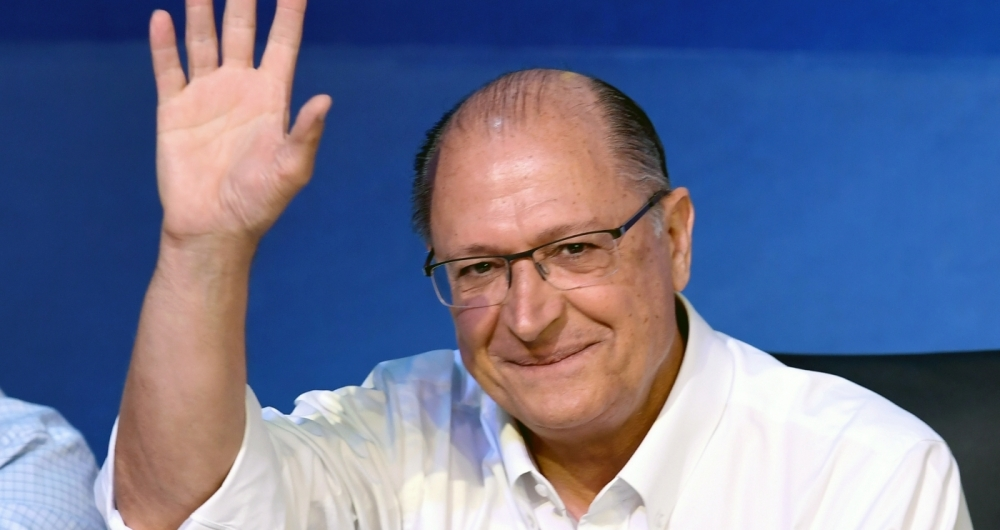 Sao Paulo's Governor Geraldo Alckmin waves during national convention of the Brazilian Social Democratic Party (PSDB), in Brasilia, on December 9, 2017.