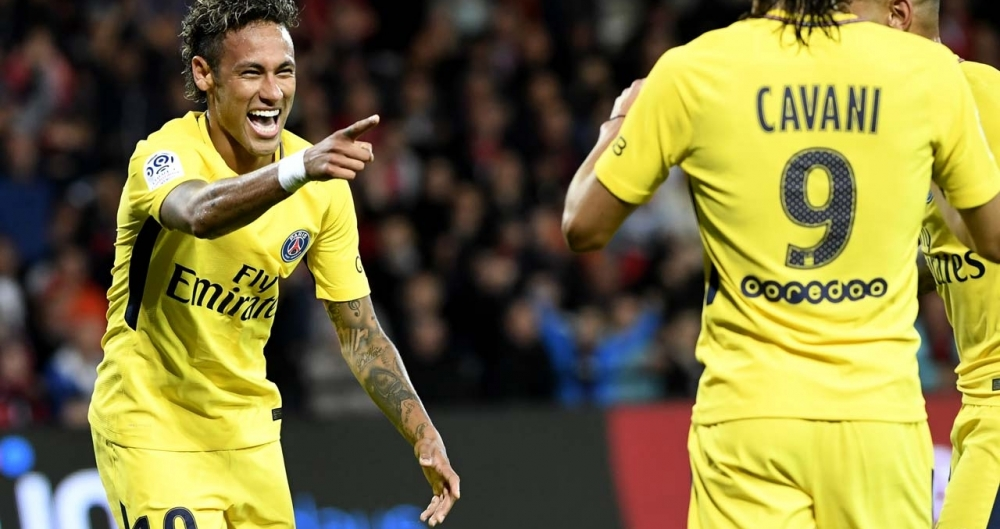 Paris Saint-Germains Brazilian forward Neymar (L) celebrates after scoring a goal during the French L1 football match Guingamp versus Paris Saint-Germain (PSG) on August 13, 2017 at the Roudourou stadium in Guingamp, western France.