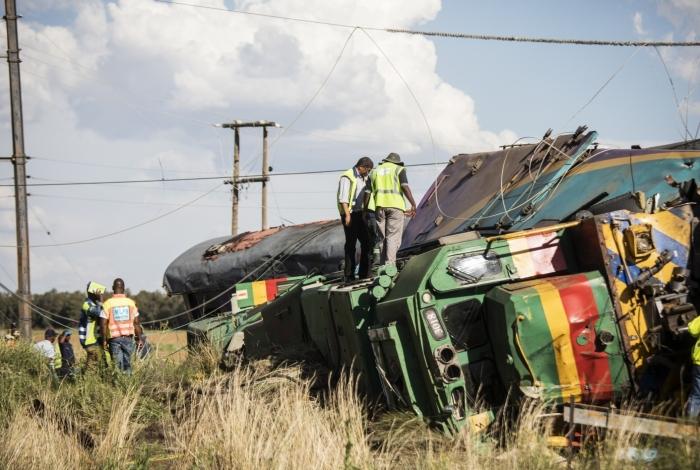 Passenger Rail Agency South Africa (PRASA) inspectors look at a derailed train locomotive after an accident near Kroonstad in the Free State Province, some 110kms south-west of Johannesburg on January 4, 2018.