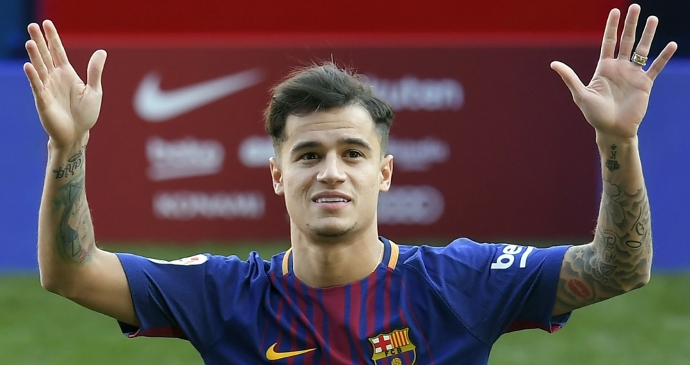 Barcelona's new Brazilian midfielder Philippe Coutinho poses with his new jersey during his official presentation in Barcelona on January 8, 2018. 