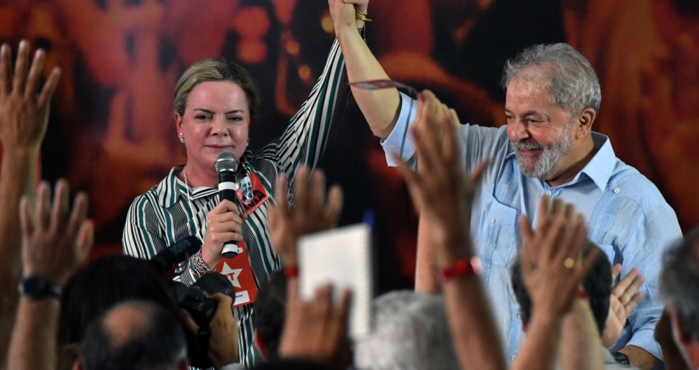 Senator Gleisi Hoffmann (L), president of Brazil's Workers Party (PT) speaks next to former Brazilian president Luiz Inacio Lula da Silva during a campaign rally to launch Lula's presidential candidacy for the upcoming October elections, at the Workers Central Union (CUT) headquarters in Sao Paulo, Brazil on January 25, 2018.