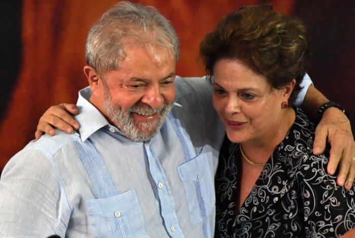Former Brazilian presidents Dilma Rousseff  (L) and Luiz Inacio Lula da Silva are pictured, during a campaign rally to launch Lula's presidential candidacy for the upcoming October elections, at the Workers Central Union (CUT) headquarters in Sao Paulo, Brazil on January 25, 2018.