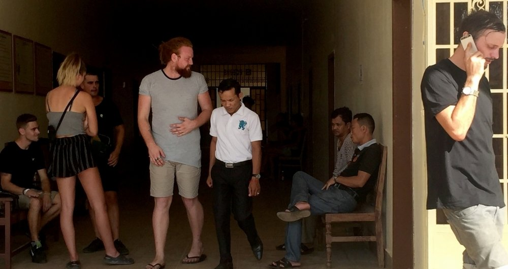This photo taken on January 27, 2018 shows a group of foreigners outside a courtroom in Siem Reap province, some who were reportedly arrested on January 25 for allegedly