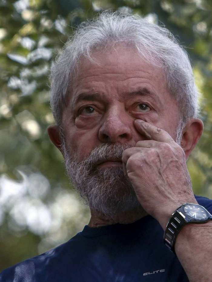Brazilian ex-president (2003-2011) Luiz Inacio Lula da Silva gestures after attending a Catholic Mass in memory of his late wife Marisa Leticia, at the metalworkers' union building in Sao Bernardo do Campo, in metropolitan Sao Paulo, Brazil, on April 7, 2018. Brazil's election frontrunner and controversial leftist icon said Saturday that he will comply with an arrest warrant to start a 12-year sentence for corruption.