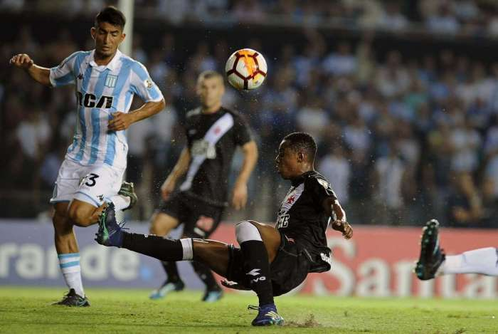5f387f87a4 Argentina s Racing Club defender Alexis Soto (L) vies for the ball with  Brazil s Vasco