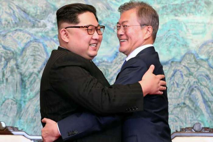 North Korea's leader Kim Jong Un (L) and South Korea's President Moon Jae-in (R) hug during a signing ceremony near the end of their historic summit at the truce village of Panmunjom on April 27, 2018. The leaders of the two Koreas held a landmark summit on April 27 after a highly symbolic handshake over the Military Demarcation Line that divides their countries, with the North's Kim Jong Un declaring they were at the