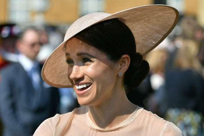 Meghan Markle, a Duquesa de Sussex, participa da festa do 70� anivers�rio do Pr�ncipe de Gales, no Pal�cio de Buckingham, em Londres (Dominic Lipinski)