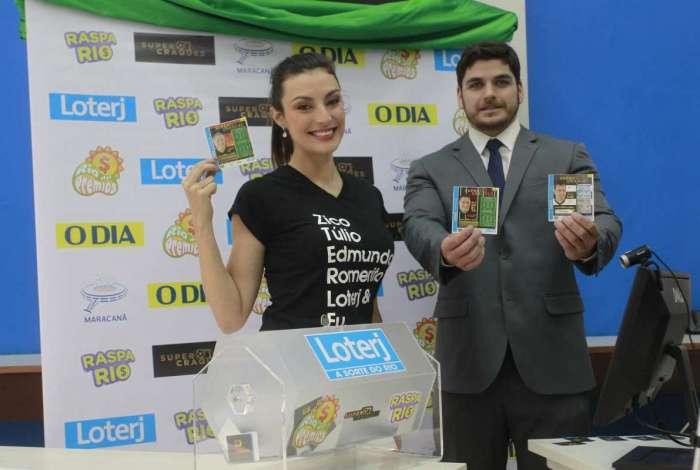 Apresentadora Aline Malafaia e Igor Nogueira, da Loterj