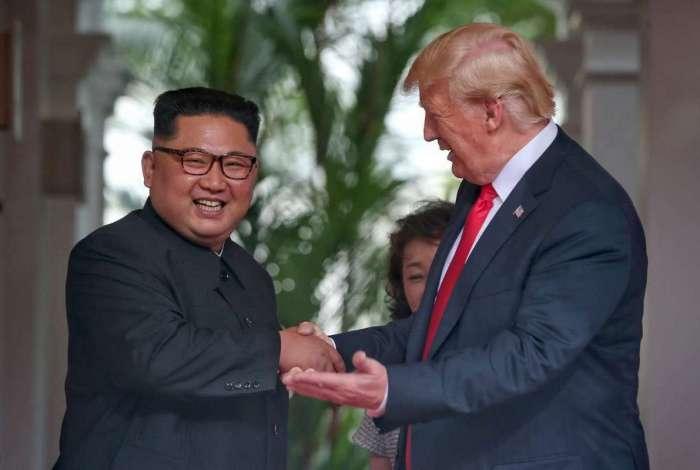 Donald Trump e Kim Jong-un, em junho deste ano