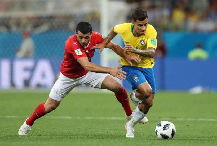 Philippe Coutinho dribla advers�rio da Su��a: meia teve bom desempenho