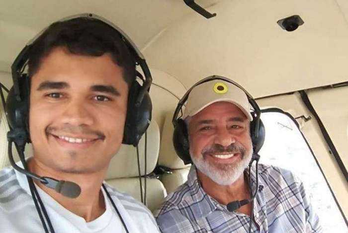 Lulu Santos e namorado em helicóptero