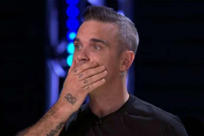 Robbie Williams se assusta com a queda do participante Tommy Ludford