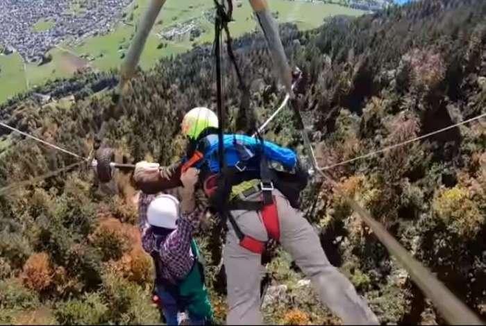 Americano fica pendurado durante seu primeiro voo de asa-delta na Suíça