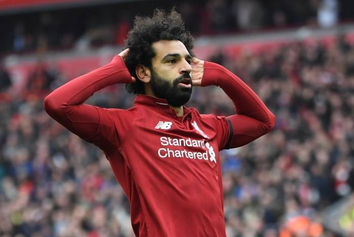 Liverpool's Egyptian midfielder Mohamed Salah gestures during the English Premier League football match between Liverpool and Chelsea at Anfield in Liverpool, north west England on April 14, 2019. 