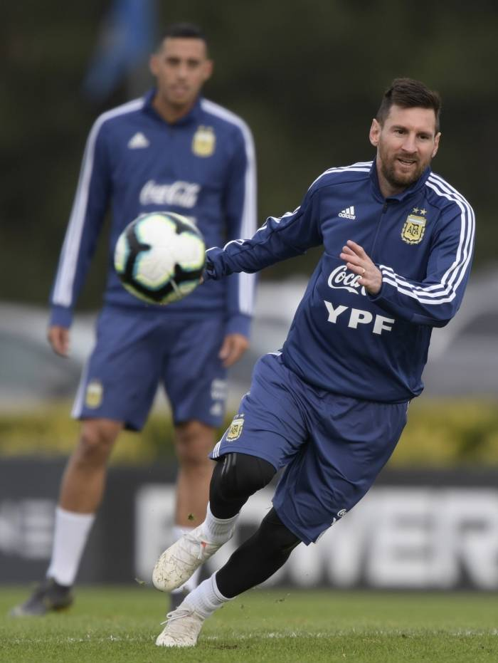 Argentina's Lionel Messi runs during a training session of the national team in Ezeiza, Buenos Aires, on June 5, 2019, ahead of the Copa America football tournament to be held in Brazil. Photo by Juan MABROMATA/AFP