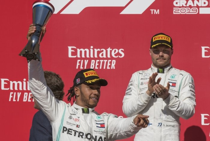 Lewis Hamilton of Great Britain driving the (44) Mercedes AMG Petronas F1 Team (L) reacts after being crowned World Champion during his second place finish, beside winner Valtteri Bottas of the Mercedes AMG Petronas F1 Team at the F1 Grand Prix of USA at Circuit of The Americas in Austin, Texas on November 03, 2019. - Lewis Hamilton claimed his sixth drivers world championship title on Sunday when he finished second at the United States Grand Prix. (Photo by Mark RALSTON / AFP)