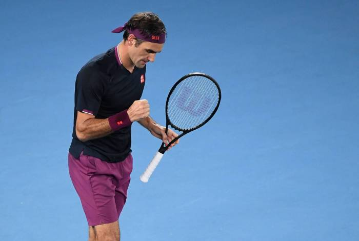 Switzerland's Roger Federer celebrates after victory against Steve Johnson of the US during their men's singles match on day one of the Australian Open tennis tournament in Melbourne on January 20, 2020. (Photo by William WEST / AFP) / IMAGE RESTRICTED TO EDITORIAL USE - STRICTLY NO COMMERCIAL USE