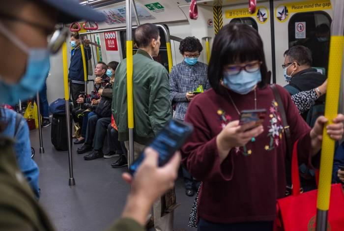População de Hong Kong se protege da disseminação do vírus