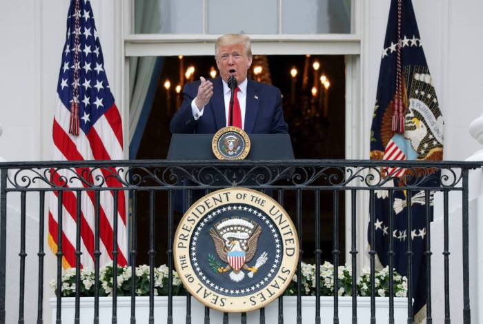 WASHINGTON, DC - MAY 22: U.S. President Donald Trump speaks from the Truman Balcony during a Rolling to Remember Ceremony: Honoring Our Nations Veterans and POW/MIA at the White House May 22, 2020 in Washington, DC. President Trump hosted the event to honor Americas veterans and fallen heroes.   Alex Wong/Getty Images/AFP